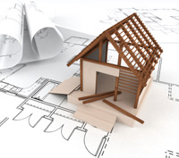 A-model-of-a-house-being-built-on-building-plans