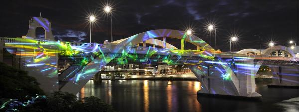 Dichroic Filter Piece by Ross Manning projected onto the William Jolly Bridge from 6-10 July 2019 in celebration of 2019 Brisbane Arts and Culture Innovation