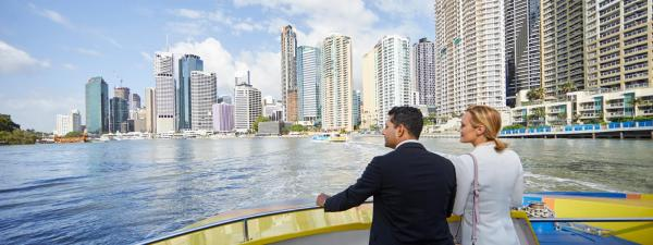 Business people on Citycat on Brisbane River
