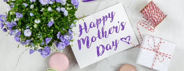 Mother's Day image with flowers, note and gifts