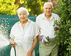 Retired couple in the garden