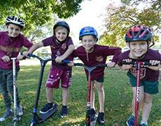 Brisbane school children on scooters