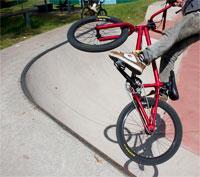 Child doing tricks on a BMX bike